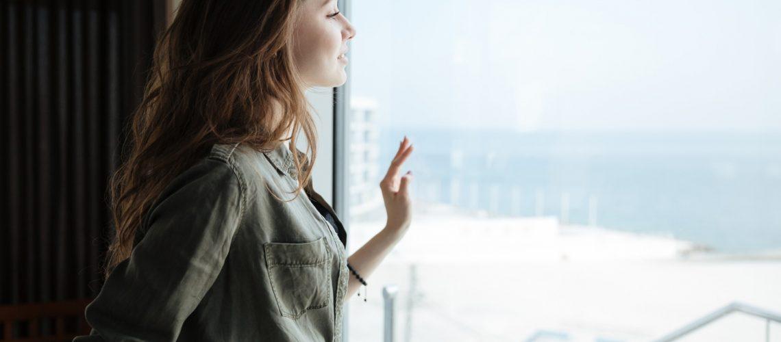 woman-looking-in-window-PX8DNFV
